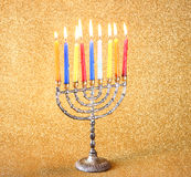 Hanukkah menorah over glitter background Royalty Free Stock Photography