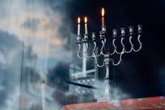 Hanukkah menorah on the second day of Hanukkah. Hanukkah menorah with three burning candles on the secound day of Hanukkah