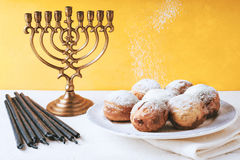 Hanukkah menorah and sufganiot on the table horizontal Stock Photography