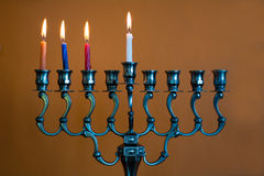 Hanukkah menorah on the third day of Hanukkah Royalty Free Stock Photos