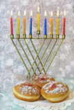 Hanukkah menorah and traditional doughnuts Royalty Free Stock Photos