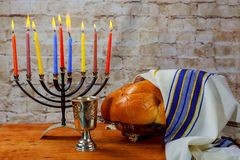 Hanukkah with menorah traditional. Low key image of jewish holiday Hanukkah with menorah traditional Candelabra and wooden dreidels spinning top . glitter Stock Photo