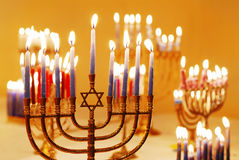 Hanukkah Menorahs. Brightly lit menorahs on the eighth night of Hanukkah stock images