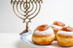Hanukkah Minor, donuts with jam on a plate on a white background. Horizontal Stock Image