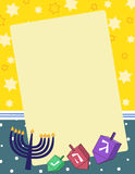 Hanukkah Note. A   illsutration of dreidels and menorahs on a blank notepad background. Eps 10 fully Royalty Free Stock Images