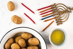 Hanukkah, olive oil and potatoes on a white background Stock Photo
