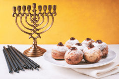 Hanukkah still life with menorah and sufganiot Royalty Free Stock Image