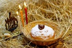 Hanukkah symbole: Hanukkah Sufganiyah, Hanukkah Menorah, Hanukkah Dreidels zdjęcia stock