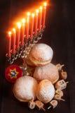 Hanukkah. Symbols of jewish holiday hanukkah - menorah, donuts sufganiyot and dreidels Stock Image