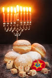 Hanukkah. Symbols of jewish holiday hanukkah - menorah, donuts sufganiyot and dreidels Stock Photo