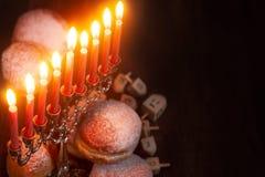 Hanukkah. Symbols of jewish holiday hanukkah - menorah, donuts sufganiyot and dreidels Royalty Free Stock Images