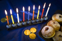 Hanukkah table with donuts and candles Royalty Free Stock Photos