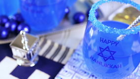 Hanukkah. Table set with cocktails and chocolates to celebrate Hanukkah stock video