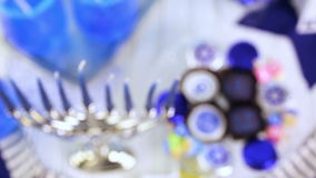 Hanukkah. Table set with cocktails and chocolates to celebrate Hanukkah stock footage