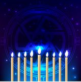 Hanukkah traditional jewish holiday. Happy Hanukkah dark blue background with Star of David, nine burning candles. Stock Photos