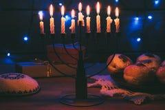 Hanukkah. Traditional jewish menorah, Kippah, presents and donuts for hanukkah celebration Stock Image