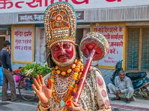 Hanuman in Rishikesh. RISHIKESH, INDIA - APRIL 4, 2010: A man dressed as Hanuman offers blessings putting a sign on your forehead, third eye stock photo