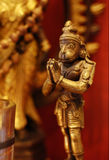 Hanuman statuette. Hanuman statue on a red altar Royalty Free Stock Photos