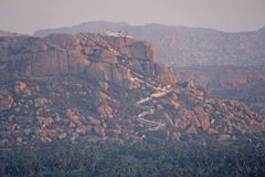 Hanuman Temple in Hampi. Anjaneya hill. Panorama view mountain a. Nd way up royalty free stock photo
