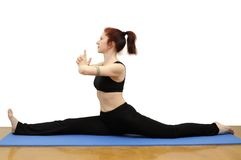 Hanumanasana. Woman in yoga posture called Hanumanasana on a blue rug,  with clipping path Stock Photos