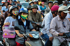 Haotic traffic in Saigon, thousands of motorbikes Royalty Free Stock Images