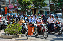 Haotic traffic in Saigon, thousands of motorbikes Stock Photos