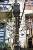 Haphazard disorganized chaotic power cables running along street lightings in Yangon Myanmar Burma. South East Asia Stock Photo