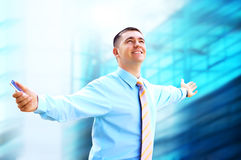Hapiness Businessman. Standing on the business background Royalty Free Stock Image