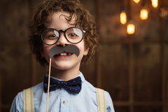 Hapiness. Smiling little hipster in studio Stock Image