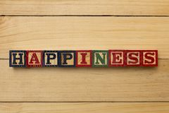Hapiness wood cube words on wooden table cool Stock Photo