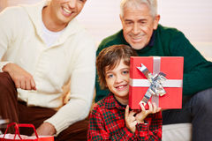 Happ boy showing gift at christmas Stock Photo