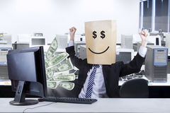 Happ face of businessman looking money Royalty Free Stock Images