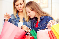 Happ ygirls shopping and holding bags Royalty Free Stock Photos
