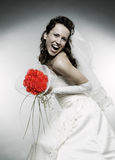 Happe bride with bunch of roses Royalty Free Stock Images