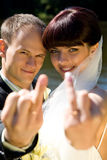 Happe couple. Happy couple is showing wedding rings with a smile Stock Photo