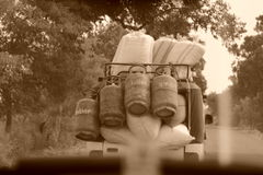 It happens only in India. An auto loaded with LPG cylinders and other materials. The photo was taken in a moving car while travelling from Bareilly to Kasganj in royalty free stock photos