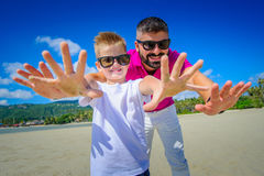 The happiest childhood: father and son having fun on the tropica Royalty Free Stock Image