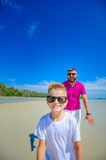 The happiest childhood: father and son running along the tropica Royalty Free Stock Photo