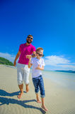 The happiest childhood: father and son running along the tropica Stock Images
