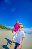 The happiest childhood: father and son running along the tropica Royalty Free Stock Photos