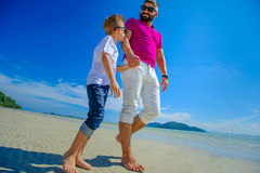 The happiest childhood: father and son walking along the tropica Royalty Free Stock Images