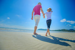 The happiest childhood: father and son walking along the tropical beach. Stock Photo