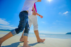 The happiest childhood: father and son walking along the tropical beach. Stock Image