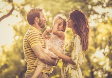 The happiest of families . Family in nature together royalty free stock image