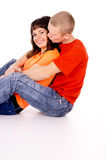 Happiest guy hugs the girl, sitting Royalty Free Stock Photo