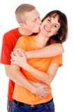 Happiest guy hugs and kisses girl Royalty Free Stock Images