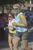 Happily Drenched Color Runners Royalty Free Stock Image