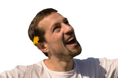 Happily enjoying spring. Isolation of a man enjoying the first spring flowers stock photography