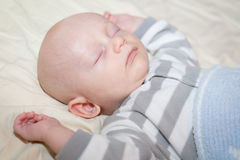 Happily Sleeping Baby Stock Photo