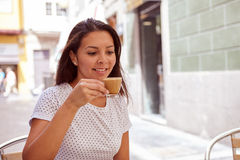 Happily smiling young girl drinking coffee Stock Photography